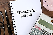 Financial Relief text on note pad