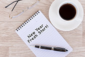 New Year fresh start text on note pad