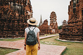 Young woman exploring a temple in Ayutthaya, Thailand