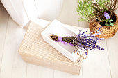 White wooden box with lavender flowers and violet bow, wedding decor. Assembled lavender on sale in wooden boxes and a basket. A lot of lavender on sale. Lavender flowers. Herbal medicine, aromatherapy