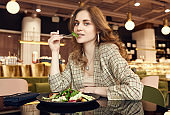 young beautiful smiling woman eating healthy food