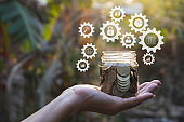Hand holding glass jar with money. financial and accounting concept.