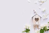 Apple blossom, birdhouse on white background