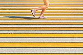 Woman running crosswalk, copy space