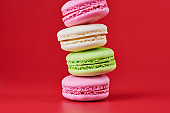 Macaroons on red background