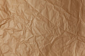 Abstract texture. Crumpled craft brown paper background. Copy space for text. Horizontal. DIY, handicraft, back to school, ecology, plastic free concept, harvesting for mock up. Flat lay, top view