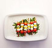 Tomato, pepper and mozzarella skewers