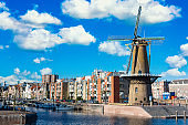 The historic Delfshaven district with windmill in Rotterdam, The Netherlands. South Holland region. Summer sunny day