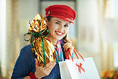 happy elegant woman with easter egg and shopping bag