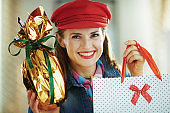 happy female with easter egg and shopping bag