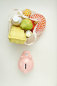 flat lay with piggy bank on white