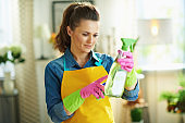 40 years old woman with cleaning agent reading instruction