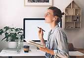 Woman freelancer indoors home office concept. Girl wearing in glasses works with new startup project.