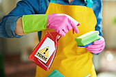 woman with cleaning agent and sponge