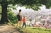 Family on background of Ljubljana, Slovenia, Europe.