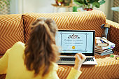 woman with electronic Certificate of Graduation screen rejoicing