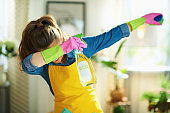 woman with cleaning agent and sponge dabbing