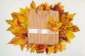 autumn background with sweater and leaves