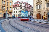 Modern trams on main square of Prague's Mala Strana next to St. Nicholas Church, Prague, Czech Republic