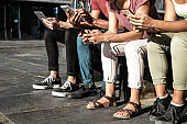 Group of people using gadgets outdoors