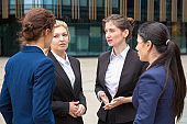 Female business group brainstorming outdoors