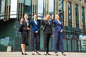Group of business women making hand gesture and inviting someone