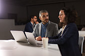 Focused business partners talking in office