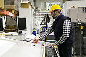 Serious male milling machine operator at his workplace