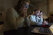 Focused business team working in dark office