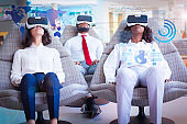 Colleagues resting in VR glasses and virtual statistic graphics