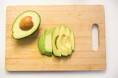 Cut parts of avocado fruit, half with seed