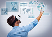 Bearded guy wearing VR goggles for virtual data analysis