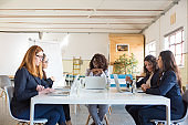 Businesswomen sitting at table in office