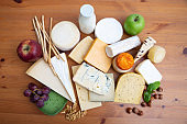 Set of cheeses, bottle of milk