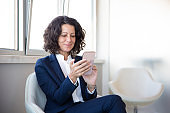 Smiling businesswoman using mobile phone