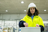 Serious industrial employee operating production process