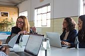 Content businesswomen working with laptops