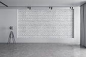 Exhibition hall interior and white brick wall with copyspace