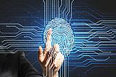 Human finger touching digital screen with fingerprint