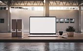 Laptop with blank screen on table in the production hal