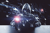 Hacker using laptop with glowing human resource interface