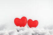 Creative red hearts on concrete background