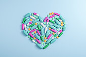 Abstract color capsule medication in form heart
