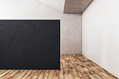 Minimalistic gallery interior with empty black wall.