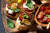 Italian appetizers - various bruschettas, top view