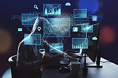 Hacker using computer with digital finance and data protection interface