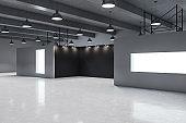 Modern gallery interior with empty banner