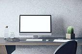 Designer desktop with empty white computer screen