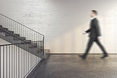 Businessman walking on stairs in office building