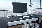 Blank black computer monitor on table